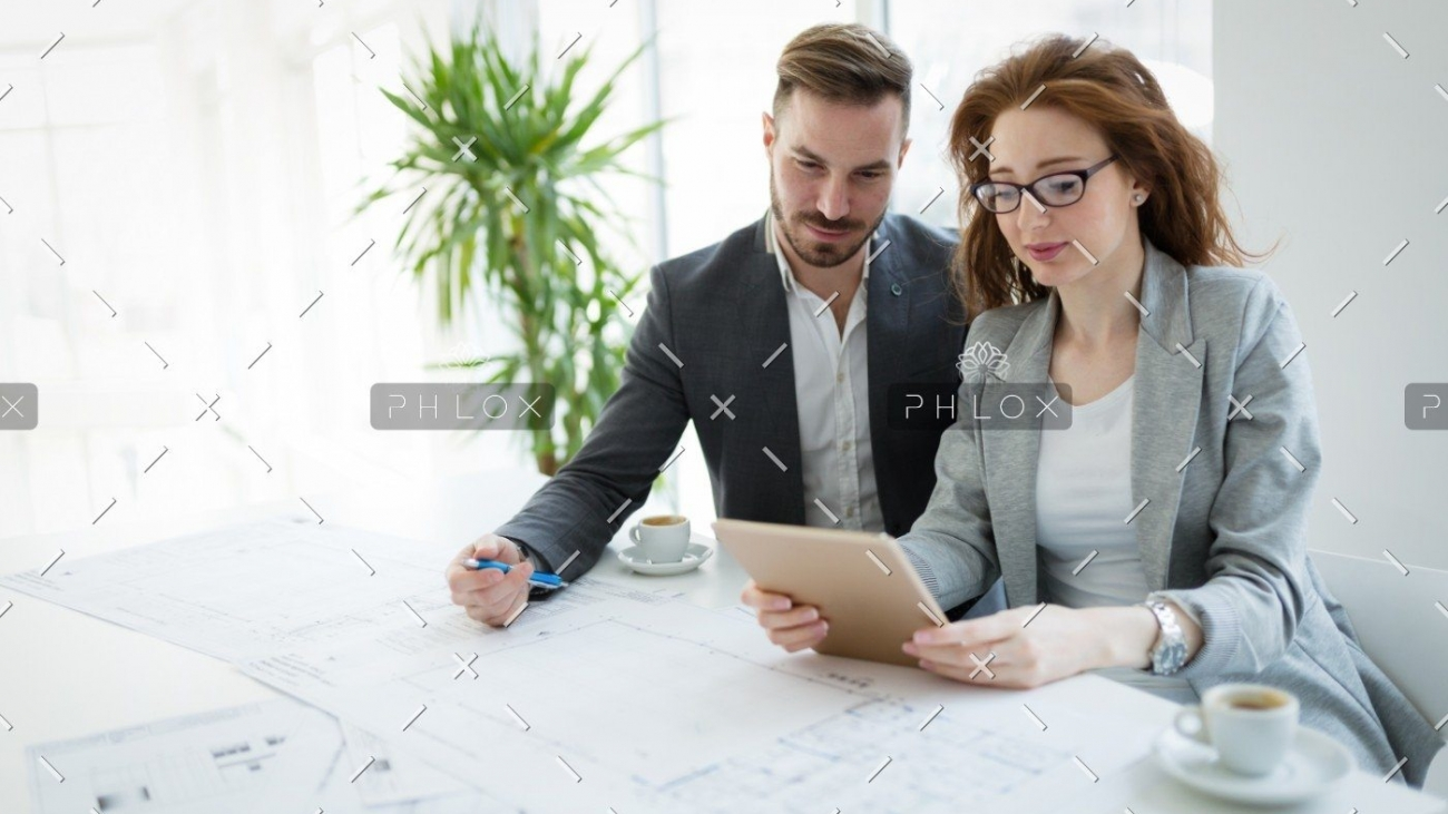 demo-attachment-337-portrait-of-young-architect-woman-on-meeting-KFZCE3A
